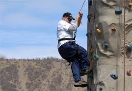 u s department of defense photo essay a disabled veteran looks for a foot hold while climbing the outdoor rock wall during the