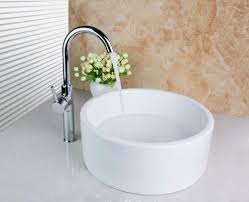 bathroom countertop basins wholesale: td white ceramic artistic contemporary countertop wash basin with brass polished chrome faucet setchina
