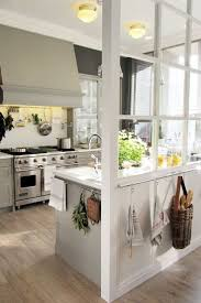 white kitchen windowed partition wall: i love the use of the paned window to divide the kitchen from the living dining whatever room is on the front side of that window