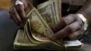 rupee notes in narendra modi just banned rs and rs a money lender counts n rupee currency notes at his shop in ahmedabad