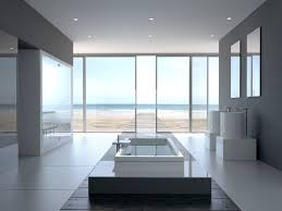 bathroom designs luxurious: huge luxurious white bathroom with floor to ceiling windows tub located in the
