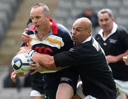 Christian Cullen is tackled by Awen Guttenbeil during the celebrity tsunami relief match between Samoa and American Samoa at Eden Park on October 18, ... - Celebrity%2BTsunami%2BRelief%2BRugby%2BMatch%2BrUzpndWBWKJl