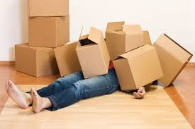 Person under a pile of moving boxes