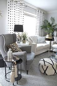 design ideas betty marketing paris themed living: neutral and eclectic living room with lots of black and white accents
