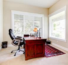 adorable home office design with brown wooden office desk plus modern swivel chair and red rug adorable home office desk