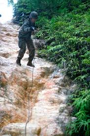 u s department of defense photo essay a u s marine rappels down a rock face during combat exercises at the jungle warfare training