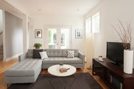 reynolds home tour inspiration for a contemporary living room remodel in other with white walls brilliant grey sofa living room