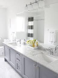 bathroom features gray shaker vanity: love the light gray vanity striped curtain