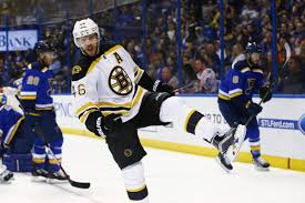 bruins erupt for six goals to keep pace in playoff race