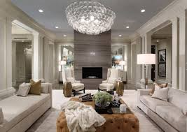 crystal chandelier and beige ottoman are the accents of the room design chic cozy living room furniture