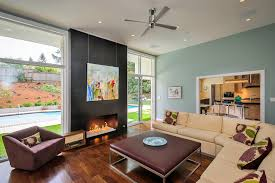 oversized ottoman family room contemporary with beige sectional beige sofa black fireplace blue beige sectional living room