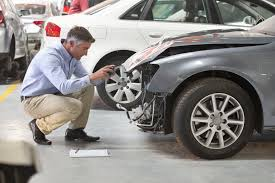 jobs and titles in maintenance insurance employee inspecting damage on a car