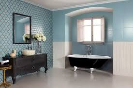 white bathroom floor: white bathroom floor tiles with blue wall colors and black vanity with single sink and mirrors