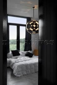 avantgarde ceiling light in contrasting black and white bedroom ceiling avant garde