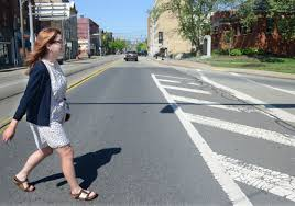 pittsburgh s commuters are walking the walk pittsburgh post gazette suzy waldo crosses east carson street on tuesday on her way to the carnegie library s south