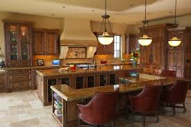 custom mahogany dining table large luxurious a richly decorated custom kitchen with large island that includes an e