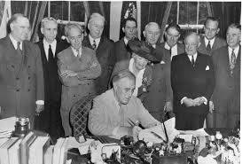 the history of the gi bill american radioworks president roosevelt signs the gi bill into law on 22 1944 photo