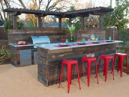 inspiring wood frame outdoor kitchen eight backyard makeovers from diy networks yard crashers countertops b