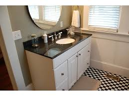 dark countertop white bathroom cabinets under frameless mirror and small window in black white bathroom floor tiles black and white bathroom furniture