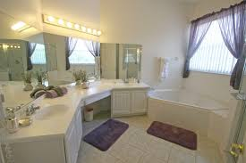 the amazing bathroom remodel ideas with large bathroom mirrors and great lighting also with wood bathroom cabinet using white color design plus purple amazing amazing bathroom lighting ideas picture