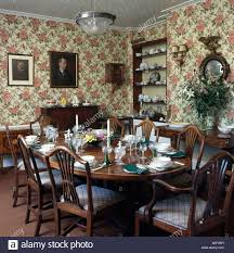 Dining Room Settings Floral Wallpaper In Formal Dining Room With Place Settings On The