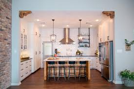 kitchen with large center island and industrial pendant lights center island lighting