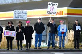 whidbey residents respond to inauguration day whidbey news times melissa duffy left from oak harbor and herta kurp from anacortes right comprised a two w protest on the corner of state route 20 and whidbey avenue