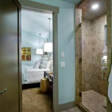 light blue bathroom with tiled shower ample shower lighting