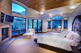 big master bedrooms couch bedroom fireplace:  view in gallery  master bedroom mountain views big windows