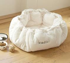 Diy? Round bed that you can cinch up. I know this is meant for cats ...