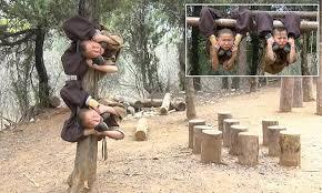 Shaolin monks display amazing flexibility as they wrap bodies ...