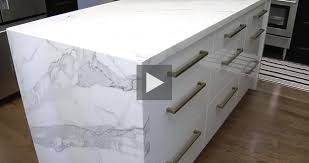 calacatta marble kitchen waterfall: gorgeous calcutta marble waterfall counter something you would not expect to see in your quintessential country kitchen