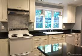 lighting above kitchen cabinets. white kitchen steel pendant light lighting above cabinets