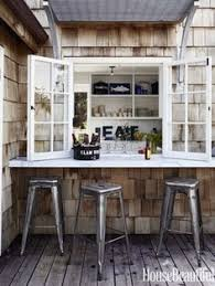 white kitchen windowed partition wall: this is a real favorite of mine in concept we use fold doors all along the kitchen counter and they open to porch where we place either a counter or