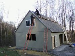 below our chadwick model garage is being built with space for two cars and additional garden tractor storage plus an upstairs office or guest room amish built home office