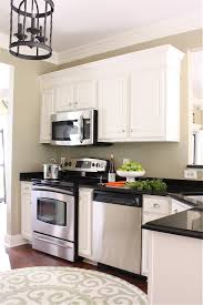 kitchen moldings: making cabinets taller builder cabinets go custom with molding