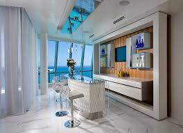 pfuner design oceanfront penthouse large trendy galley seated home bar photo in miami with no sink black mini bar home