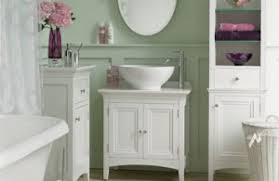 country bathroom colors: simple white furniture and fixtures combined with light pastels and a few bold pops of color