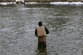 standing in the water fishing