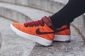 a bright nike flyknit air force 1 in total crimson air force 1 flyknit