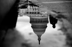 whistleblowing is not just leaking it s an act of political the u s capitol is reflected in a puddle next to the capitol reflecting pool in washington