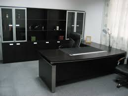 black office furniture design with l table and 2 executive office chair also cabinet with glass black office desks