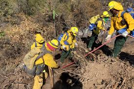 u s department of defense photo essay california army national guardsmen extinguish a small fire while fighting the rocky fire near clear lake