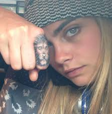 Cara Delevingne Finger Tattoo