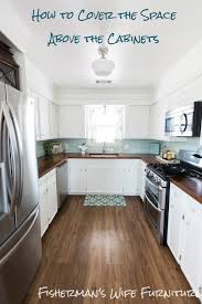 above kitchen cabinet arrangements decorating kitchen you know that annoying space between the top of the kitchen cabinets and the above kitchen cabinet lighting