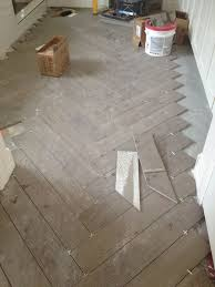 ceramic tile for bathroom floors: love this herringbone pattern wood look tile for my back entry floor durable to wet