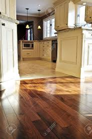 Hardwood Or Tile In Kitchen Hardwood And Tile Floor In Residential Home Kitchen And Dining