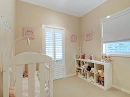 colours for a bedroom: childrens room bedroom design idea with carpet amp french doors using beige colours bedroom photo