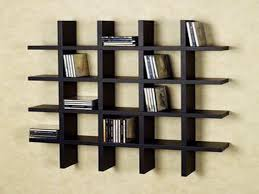interior crossed black wooden wall shelves for books placed on the cream wall amazing contemporary wall bookshelf furniture design