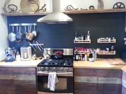 reclaimed barn wooden kitchen cabinets dark barn siding gives these kitchen cabinets a reclaimed wood facelift the